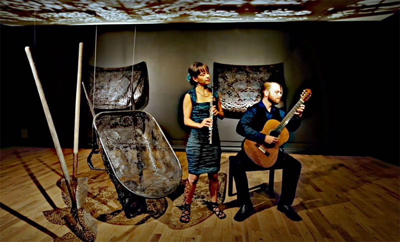 Duo Beija-Flor's Marie-Noelle Choquette, with flute, and Charles Hobson, holding a guitar.