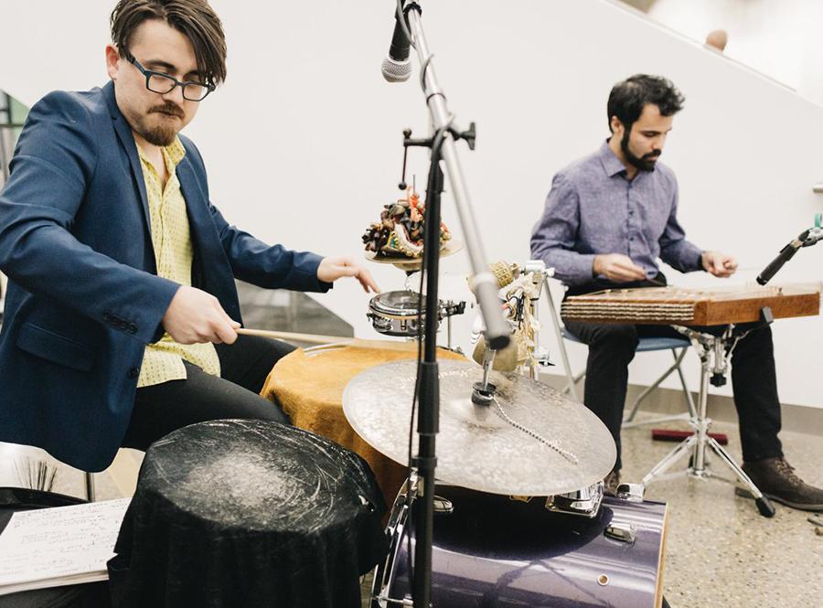 casual image of Daniel Stadnicki on percussion and Farnad Khosravi on santur